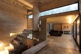 modern masonry cool concrete cabin warm wood patio