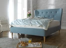 soft bed frame soft blue leather bed frame with light brown wooden legs combined