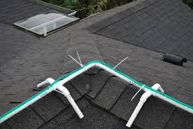 Blow Up Christmas Decorations On Roof by Frame For Installing Christmas Rope Lights On Ridgeline Of Roof 4
