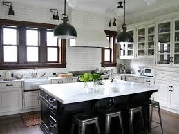 wood countertops black and white kitchen cabinets lighting