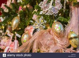 gold and pink christmas decorations and pink ribbon on a richly