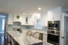 an elegant kitchen design with a curved milk glass tile backsplash