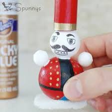 artbyangeli diy nutcracker ornament out of toilet paper roll
