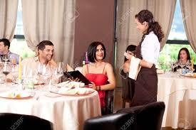 waitress taking dinner order restaurant table stock