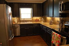 Dark Grey Kitchen Cabinets by Light Floors Dark Cabinets Yellow Pendant Lamps What Countertop
