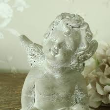 sitting cherub ornament melody maison