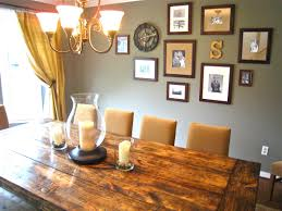 dining room rustic wood dining table and frame art on grey wall