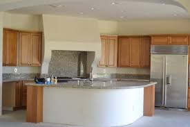 vivpodesigns standard builder cabinets and this very bulky hood odd shaped island
