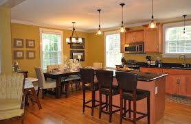 recessed lighting over dining room table and with cool inspiration
