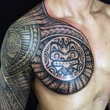 collection of 25 tribal tattoos on chest and arms