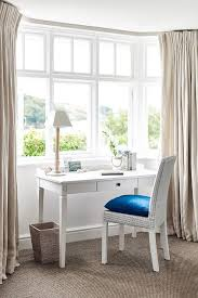 white french desk with white wicker chair cottage bedroom