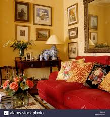 patterned cushions on red sofa in living room with a traditional