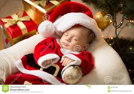 baby boy christmas newborn baby boy in santa clothes lying christmas tree stock