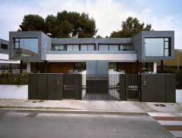 Modern House Design by Spectacular Shaped Twin House Design U2013 Antonio Altarriba Comes