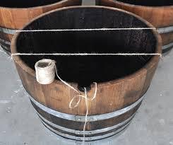 diy wine barrel planter how to make a wine barrel planter