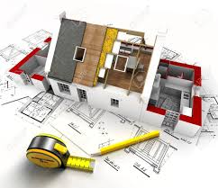 aerial view of a house under construction with blueprints and aerial view of a house under construction with blueprints and architect work tools stock photo