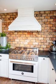 kitchen grey brick backsplash cailing light dark marble grey brick backsplash cailing light dark marble countertop dark wooden wall cabinets electric range hood laminate ceramic floor