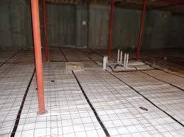 the basement slab is ready for radiant heat tubing to be installed
