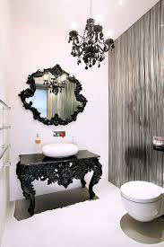 beautifully crafted black table with ornate design acts as vanity