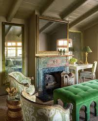green and gold living room with emerald green velvet tufted bench
