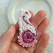 then she began creating pendants brooches and jewelry using polymer clay