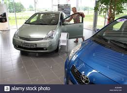 toyota showroom toyota prius hybrid car in a toyota showroom stock photo royalty