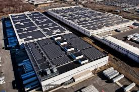 solar panels png amazon pledges to cover 15 massive warehouse rooftops with solar