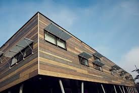 rivestimento facciate in legno con woods la pietra diventa legno geometra info