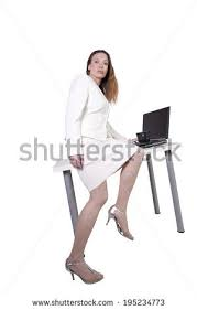 Sitting On The Desk Beautiful Woman Sitting On Desk Stock Photo 140223310