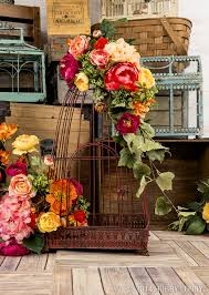 cover a birdcage with beautiful blooms for lovely home decor