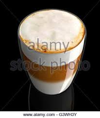 cup of coffee latte with foam isolated on white background top
