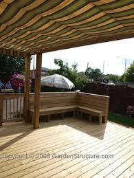 Pergola Deck Designs by Aerial View Of Pergola Over Deck With Herringbone Shade Boards