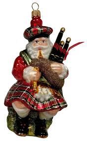 scottish santa in kilt with bagpipes glass