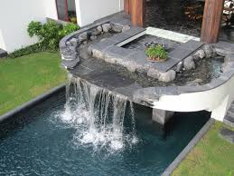 pool waterfalls and black slate lava rock stream bed water