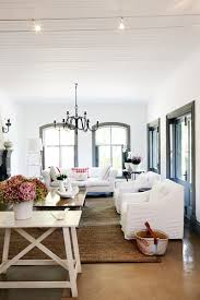 white walls with dark gray trim black windows for the home