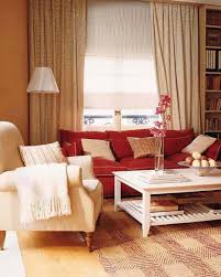 floor l with red shade beige stain wall featuring red fabric comfy sofa and white fabric