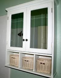 high white wooden cabinet with wooden shelf and double door over