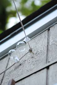 Backyard Patio Lighting Ideas by How To Hang Outdoor String Lights The Deck Diaries Part 3