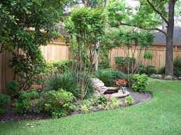 backyard landscaping with trees and metal furniture nice