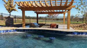 Backyard Pub And Grill by Blue Haven Pools Of Kansas City Custom Pool With Swim Up Bar And