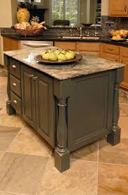 oak kitchen island with granite top colors that go with honey oak cabinets design in wood