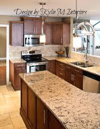 kitchen travertine floor dark caninet backsplash maple cabinets