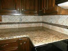 backsplash with gold granite countertop here are santa cecilia
