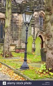victorian lamp post in church grave yard in sandbach cheshire uk