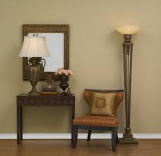 elegant torchiere floor lamp placed near side chair and console
