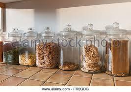 green lentils in glass kitchen storage jar stock photo royalty