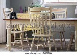 country style dining room table a country style dining room with french doors leading outside stock