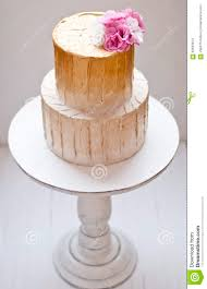 gold and white wedding cake stock photo image 62633974