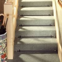 interior brown striped stair runner have borders on white wooden