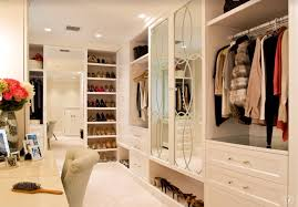traditional closet with walk in closet u0026 built in bookshelf